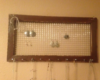 Jewelry organizer frame with rustic hooks/pegs. Great alternative to a jewelry box for storage and organization
