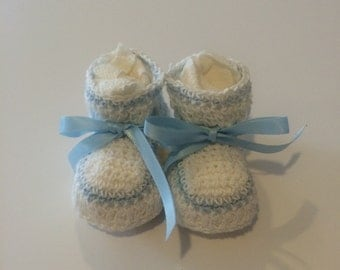 Newborn  crocheted baby booties with blue stripe and satin ribbon . Different color options available.