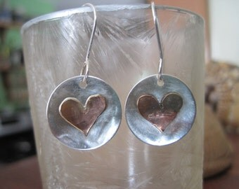 Sterling silver and copper heart earrings.