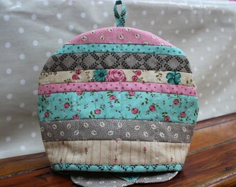 Handmade patchwork tea cosy with layer-cake patch effect. Padded and lined.