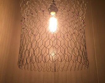 Pendant/ hanging lamp handmade w/chicken wire, purple shells, and green vintage blown glass