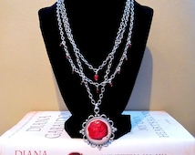 Outlander inspired Written in My Own Heart's Blood/MOBY necklace with red glass bead accents