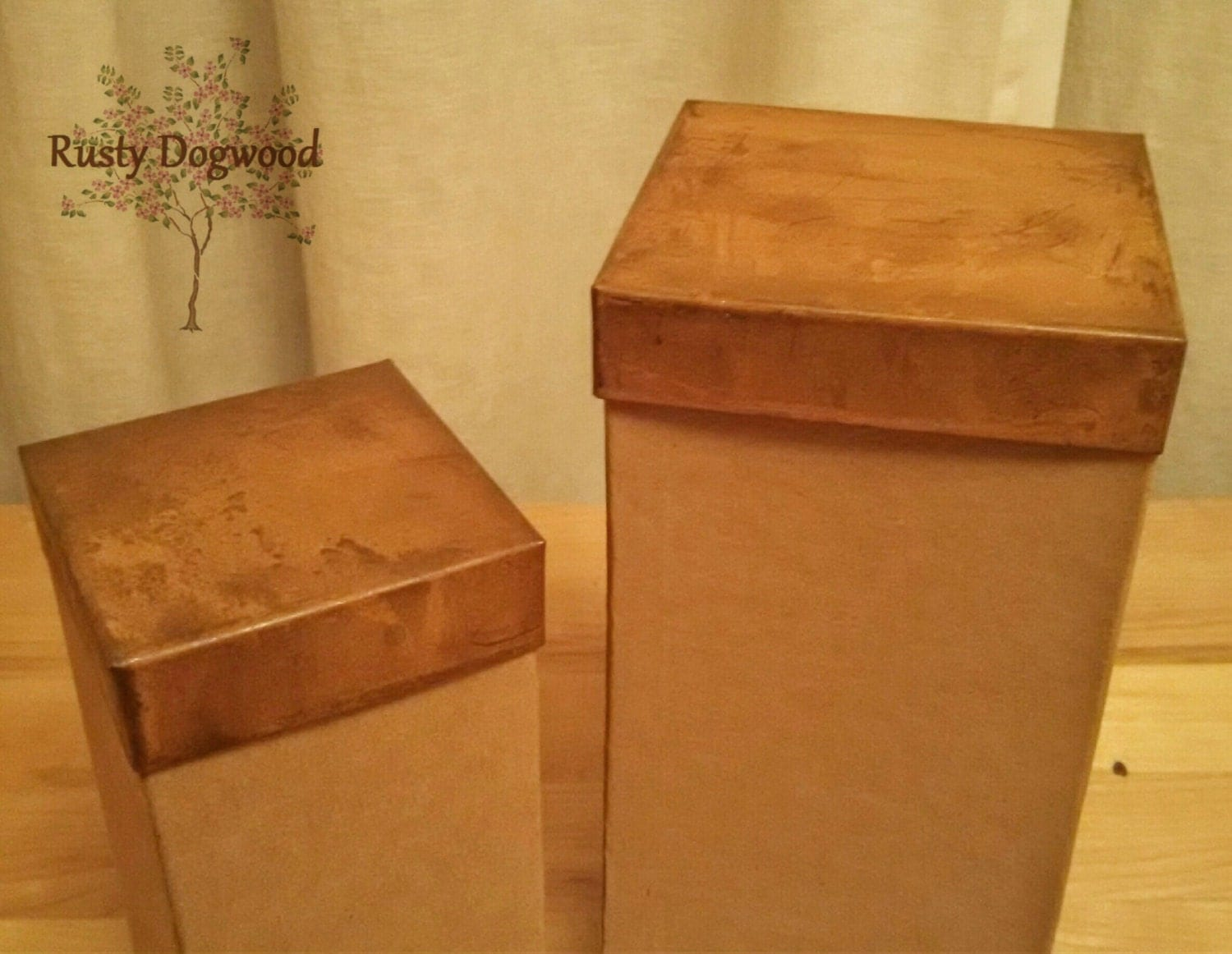 rusty coppery tin lids on two tall cardboard boxes. Black Bedroom Furniture Sets. Home Design Ideas