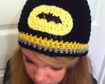 Black beanie style hat with Bat motif, available with or without earflaps.