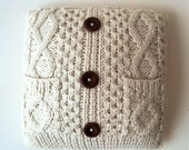 Cable Knit Fisherman's Pillow. Wool Blend. Chunky cable knit pattern in cardigan design with playful pockets. Vintage feel.