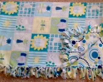 Animal print fleece tie blanket, reversible fleece tie blanket