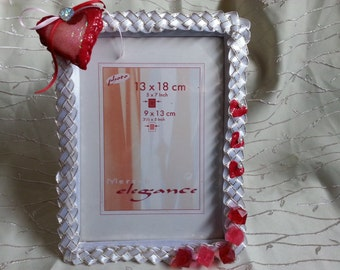 Day of St. Valentina.Serdechny gift for lovers. Heart with love. Frame for photo lovers or family ph.