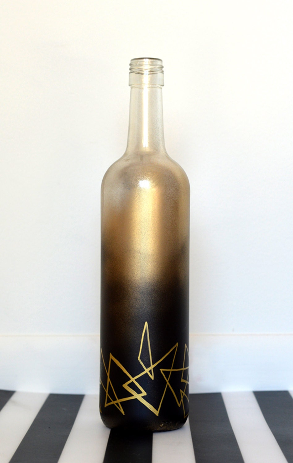 decorative wine bottle spray painted with hand drawn design. Black Bedroom Furniture Sets. Home Design Ideas