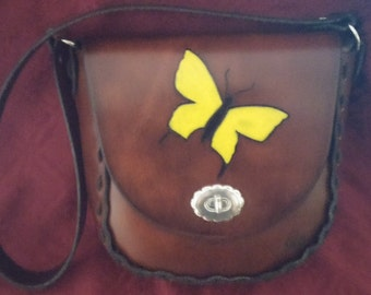 This is a dark, rich, latigo leather bag