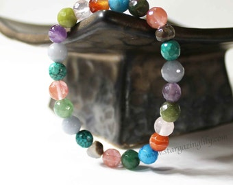 ONE Semi-precious stone bracelet. You will also receive a color print out of what each stone is and the power it's believed to hold.
