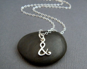 """tiny silver ampersand necklace. small sterling cursive pendant. whimsical font. simple everyday jewelry. dainty. delicate. and symbol 3/8"""""""