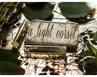 a tight corset - natural perfume oil mini sampler twin pack - primary notes: aged moroccan amber & cardamom