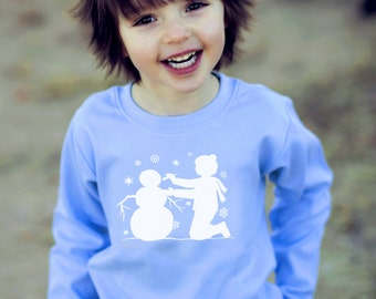 Building a Snowman Long Sleeved Crew by Nostalgic Graphic Tees in Sky/White