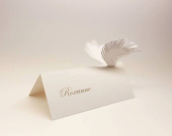 Bird wings on card | White wedding place cards | Flying name cards