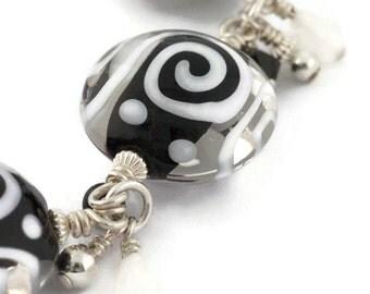 Handmade Art Glass Bracelet - Lentil shape - Black and White - Lampwork - Fun and Modern - Jazzy Funky Swirls -