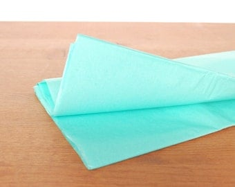 teal tissue paper: light teal gift wrap, tissue, stuffing