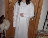 Long white cotton underdress in a regular size with flaring hem.