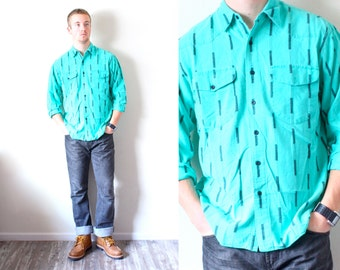 Vintage mens turquoise long sleeve shirt // aztec black navajo button up shirt // tribal print boyfriend shirt // southwestern