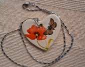 Heart pendant with poppy and butterfly , stainless steel chain, two-sided: red heart or red flower and butterfly