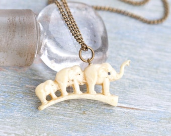 Family of Elephants Necklace - Antique Celluloid animal Charm on a chain