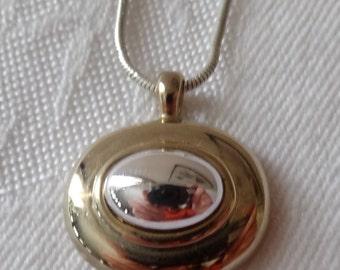 Vintage modernist necklace shiny sleek oval gold tone and silver tone pendant