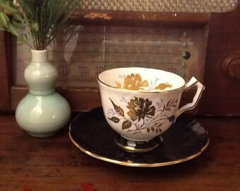 Antique Aynsley Bone China Teacup and Saucer Black And Gold Floral