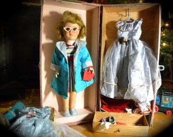 Plastic Doll With Wardrobe