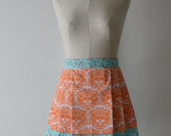 The Two Tier Pleated Apron In Tangerine & Turquoise