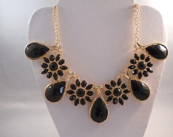Bib Necklace with Gold, Black Crystal and Clear Rhinestone Pendants on a Gold Tone Chain