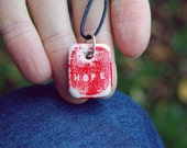 Custom made word necklace with hand engraved pendant in hot red