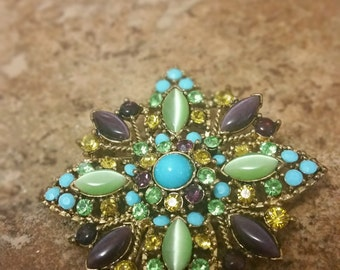 Incredible vintage brooch in gold tone metal,  green, purple and Turquoise color glass beads accented with gold and green rhinestones