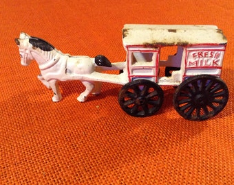 Cast Iron Horse Drawn Fresh Milk Wagon, Toy painted White with black wheels and red trim