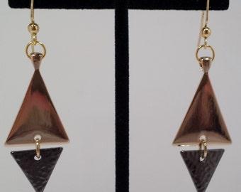 Gold and black geometric dangle earrings.