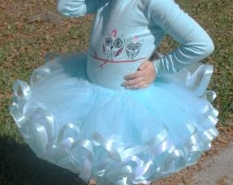 Light aqua blue ice princess ribbon trimmed extra fluffy tutu. White and light aqua blue satin ribbon trim.