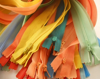 ZIPPERS:  SET of 43 ZIPPERS, 22 inch closed end, beulon, mixed colors.