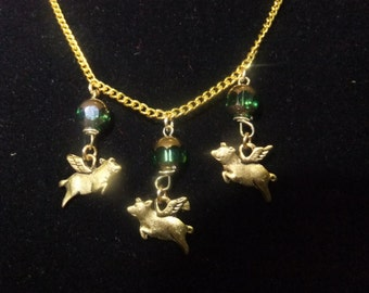 Gold and Green Flying Pig Necklace