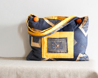 Grey and yellow large bag with pockets