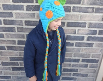Dinosaur hat! Crocheted dinosaur hat with plates, spots, ear flaps and braids. Bright and colorful boy's dinosaur hat!