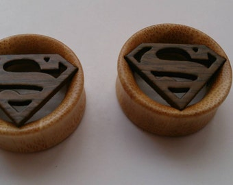 Superman (DC comics) gauges plugs made out of hard bamboo wood sizes are in MM 12, 14, 16, 18, 20, 22, 24, 26, 28 MM cc