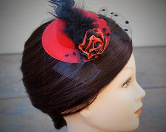 Red and black fascinator hat, clip on