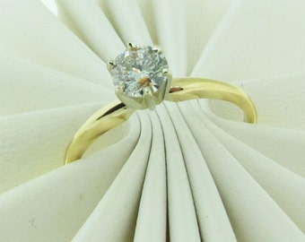 14 K gold and diamond solitaire engagement ring.