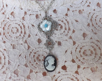 Cameo and flower charm necklace.