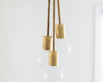 Triple hanging brass bubble light