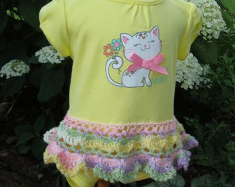size 12 mos Short sleeve yellow onesie dress with added hand crocheted lace skirt in soft pastels. So cute kitten screen with pink bow.