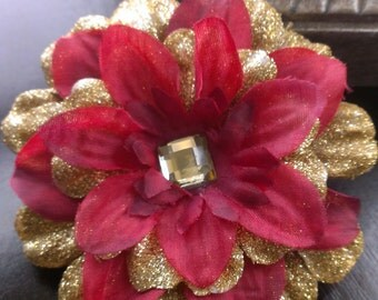 Red and glittered flower pin/clip centered with a gold gem