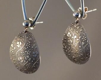 Patterned sterling post earrings.