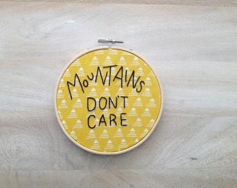 "5 inch ""Mountains Don't Care"" - Hand Embroidered Hoop Wall Art"