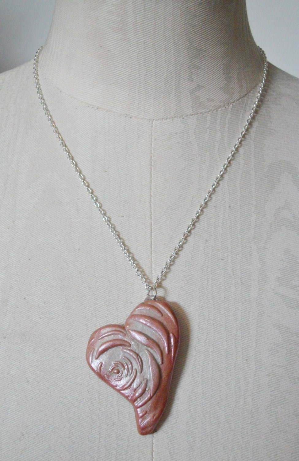 Handcrafted necklace 'Rosie Impression' featuring a sculpted pink and pearly metallic burnished heart. steampunk buy now online