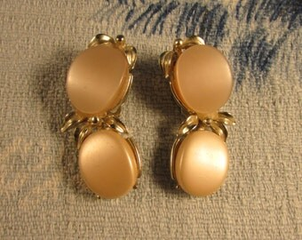1960s silver-tone thermoset clip-on earrings, large peach cabochons