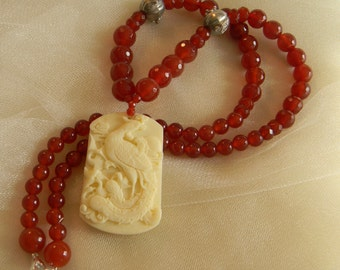 Bone phoenix pendant w long red carnelian beads necklace , bead jewelry , molded bone & resin pendant , carnelian necklace , phoenix jewelry
